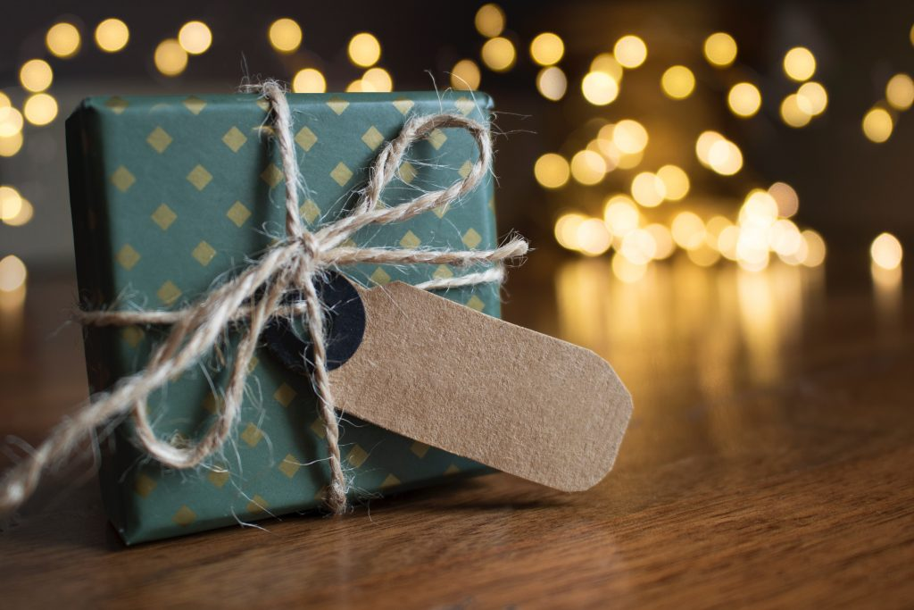 gift with paper tag and fairy lights